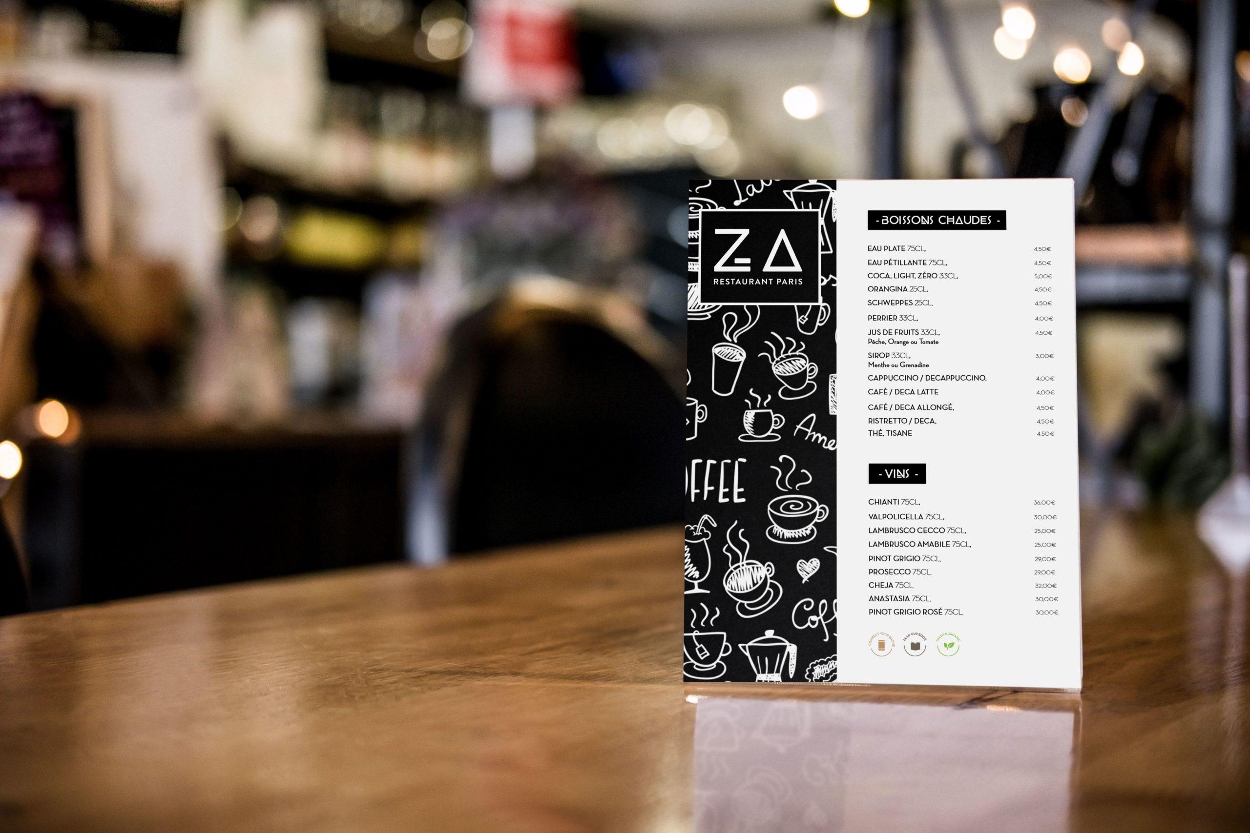 Carte du restaurant Za Paris posé sur une table à l'intérieur du restaurant